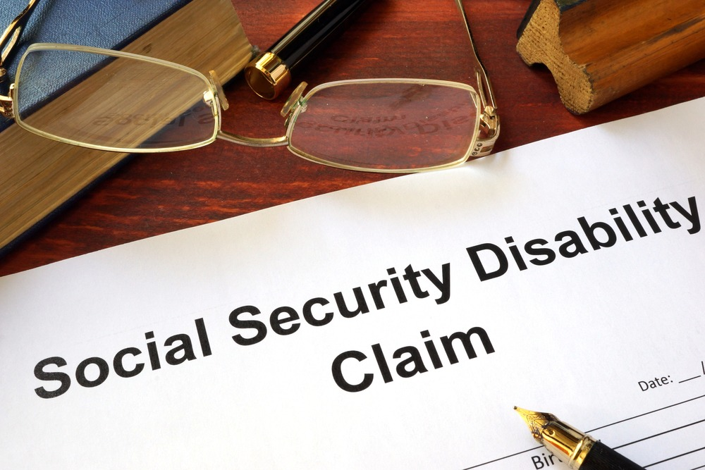 Social security claim document on a desk.