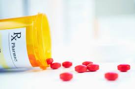 Bottle of pharmacy prescribed pills.
